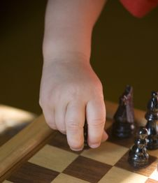 Child Playing Chess Royalty Free Stock Photos