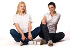 Blonde And Brunette Sits On The Floor Royalty Free Stock Photos