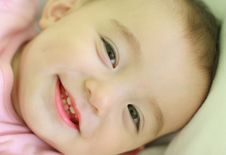 Free Cute Baby Girl Smiling Stock Image - 3309691
