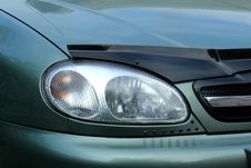 Free Fragment Of A Car. The Right Front Headlight Stock Photography - 33007882