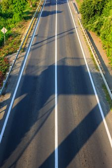 Free Early Shadow On An Empty Road Stock Image - 33015801