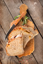 Free Bread With Knife On A Cutting Board Stock Photography - 33025702