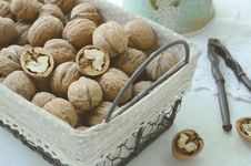 Free Walnut In Wire Basket Stock Image - 33029041
