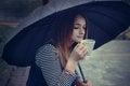 Free Beautiful Girl During A Rain Under Umbrella Drinks Hot Coffee Stock Image - 33030231