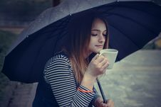 Free Beautiful Girl During A Rain Under Umbrella Drinks Hot Coffee Stock Image - 33030231