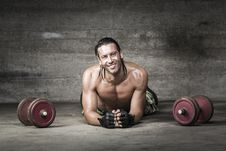 Portrait Of Muscle And Smiling Athlete Stock Image