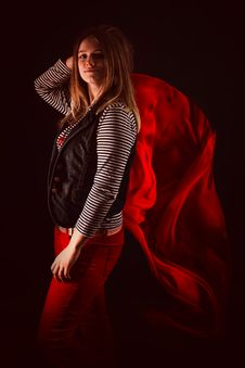 Free Beautiful Girl Against Red Fabric In The Dark Stock Photography - 33046972