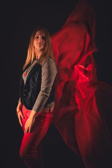 Free Beautiful Girl Against Red Fabric In The Dark Stock Photos - 33047033