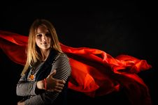 Free Beautiful Girl Against Red Fabric In The Dark Stock Photography - 33047152