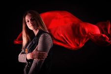 Beautiful Girl Against Red Fabric In The Dark Stock Images