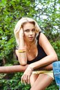 Free Portrait Of Blond Woman In A Park Stock Photo - 33058510