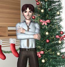 Young Man And Christmas Tree Stock Image