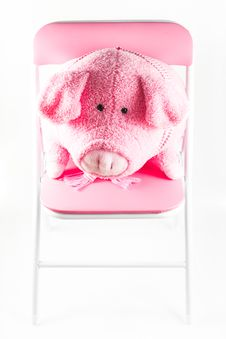 Free Pink Fabric Pig Is On A Chair Royalty Free Stock Photo - 33059085