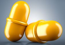 Free Two Golden Pills Stock Photography - 33087362