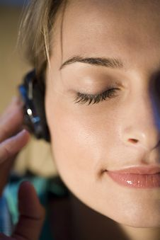 A Woman Listening To Music Stock Photos