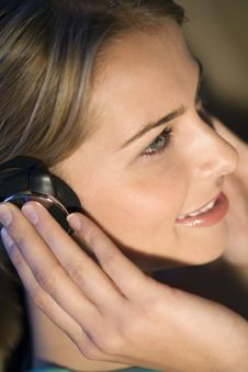 A Woman Listening To Music Royalty Free Stock Photos