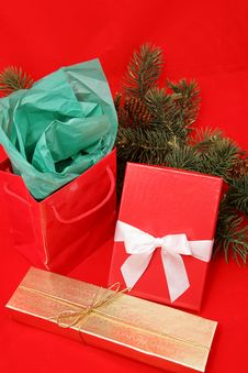 Free Christmas Gifts On Red Royalty Free Stock Photo - 3315695