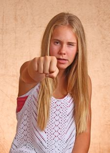 Free Young Girl With Angry Fist Stock Photography - 33102662