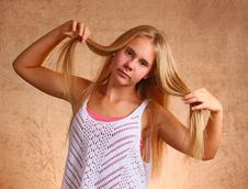 Free Young Girl Holding Hair Royalty Free Stock Photo - 33102865