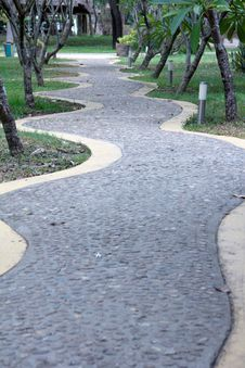 Curved Rock Road Resort Walk Way Green Tree Royalty Free Stock Photography