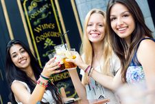Free Friends Taking A Drink On A Terrace Stock Photos - 33135363