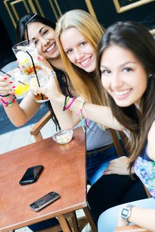 Friends Taking A Drink On A Terrace Royalty Free Stock Photos