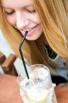 Free Pretty Blonde Girl Taking A Drink On A Terrace Royalty Free Stock Photo - 33135815