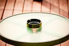 Free Empty Ashtray Stands In The Middle Of A Round Glass Table Stock Photography - 33141472