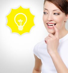 Free Smiling White Woman With Electric Lamp Stock Photography - 33152712