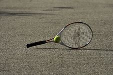 Free Tennis Racket And Ball On The Ground Royalty Free Stock Photos - 33158238