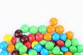 Free Chocolate Balls In Colorful Glaze Are Bottom. Stock Images - 33182644