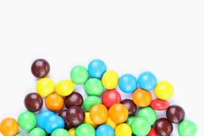 Free Chocolate Balls In Colorful Glaze Are Bottom. Stock Photo - 33182630