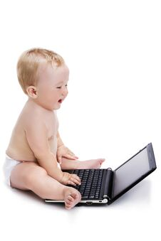 Free Smiling Baby Typing On A Black Laptop Royalty Free Stock Images - 33194149