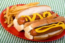 Free Hotdogs With Mustard Royalty Free Stock Photography - 33198537