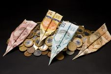 Money Airplane And Coins Royalty Free Stock Image