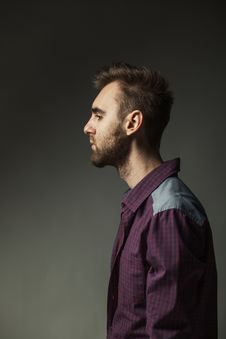 Young Adult Man On A Dark Background Stock Photos
