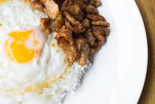 Fried Pork With Pepper And Garlic Serve With Fried Egg And Cooke Royalty Free Stock Photos