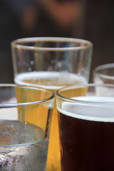 Icy Glasses Of Light And Dark Beers Stock Photography