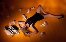 Free Girl Lying Beside The Typewriter Stock Photography - 33263062