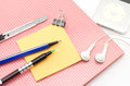Free Red Notebook With Post It And Bulldog Clip Blue Pen Cutter Ear P Royalty Free Stock Photography - 33271687