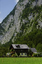 Free House Under The Alps Cliff Stock Photography - 33274702