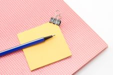 Red Notebook With Post It And Bulldog Clip Blue Pen Isolated On