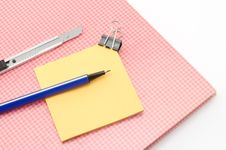 Red Notebook With Post It And Bulldog Clip Blue Pen Cutter Isola