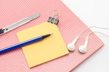 Free Red Notebook With Post It And Bulldog Clip Blue Pen Cutter Ear P Stock Photos - 33271423