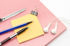 Free Red Notebook With Post It And Bulldog Clip Blue Pen Cutter Ear P Stock Photos - 33271563