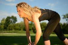 Female Model Exercises In The Park Royalty Free Stock Photos
