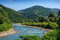 Free River Meanders At The Mountain Foot Stock Images - 33291044