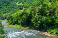 Free River Turns Near At Mountain Foot Stock Photo - 33291230