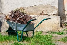 Wheelbarrow Near The Old Wall Stock Photography