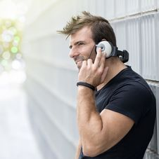 Free Portrait Of Man Listening To Music Wiyh Headphones Against In Ab Royalty Free Stock Images - 33296829